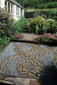 Pebble snake mosaic by Susie Lawson