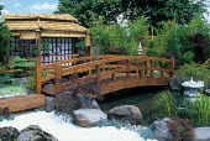 Japanese bridge over pond, stone boulders