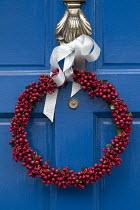 Berry wreath on blue front door