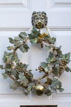 Christmas wreath on white front door
