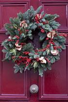 Christmas door wreath with berries and fruit