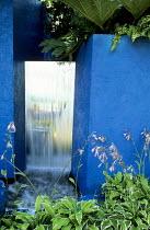 Painted blue wall, mirror fountain, hostas