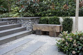 Timber bench, large paving slabs and gravel