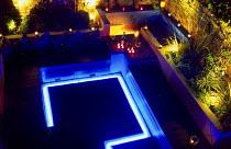 Overview of patio garden, blue floor lighting, spots, tealight candles