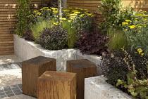 Wooden block stools, achilleas, Stipa tenuissima
