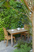Living green wall, wooden table and chairs