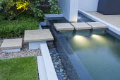 Stepping stones across contemporary infinity pool