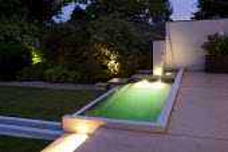 Contemporary lighting, pond on patio
