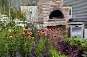 Outdoor pizza oven, raised bed with echinacea, helenium, fennel and herbs