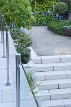 Steps to upper level with Bredon gravel, glass panels