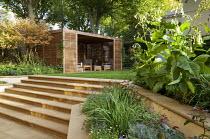 York stone steps to lawn, timber summerhouse, Nicotiana sylvestris