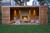 Timber pavilion with seating and outdoor fireplace