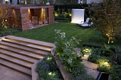Overview of lit town garden, Nicotiana sylvestris, York stone steps, contemporary timber pavilion