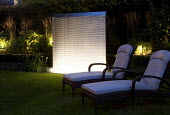 Water wall lit with LED lights, reclining chairs