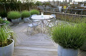 Roof terrace, decking, table and chairs, lavender in dolly tub containers