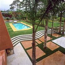 View to swimming pool, wavy steps, geometric paving