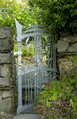 Stone wall, floral motif metal gate by Paul Woodmass