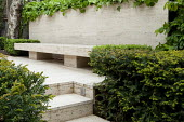 Travertine bench, paving and wall covering