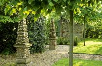 Lime trees, flint stone obelisks