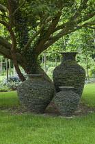 Slate urns under tree