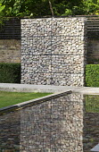 Stone gabion wall, reflective pool, clipped box hedges