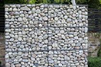 Stone gabion wall