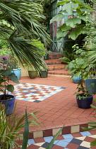 Geometric tile pattern in Moroccan-inspired courtyard garden