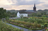 Walled garden with fruit, vegetables and flowers, mixed grape vine, church