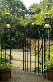 Blue metal gate with gold finials