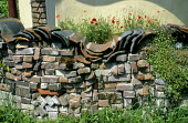Wall made from reclaimed bricks and tiles
