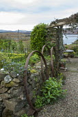 Salvaged metal rings against dry-stone wall