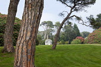 View across lawn to Edwardian summerhouse, Scots pines