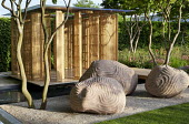 Carved stone sculptures by Peter Randall-Page, bamboo pavilion by Kengo Kuma