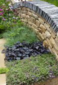 Dry-stone wall topped with slate