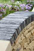 Dry-stone wall topped with curved slate