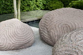 Japanese inspired garden with sculpted boulders and stone water feature
