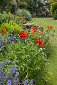 Staddle stone in border, Sweet William, poppies, hardy geraniums, nepeta