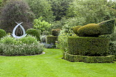 Topiary birds in white garden, sculpture by Pete Moorhouse in circular border with lavender