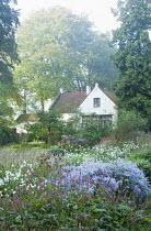 White cottage, Aster 'Photograph', Persicaria amplexicaulis
