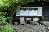 Willow chairs by garden shed