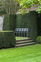 Garden 'room', yew hedge enclosing contemporary metal bench