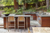 Outdoor kitchen, stools by breakfast bar