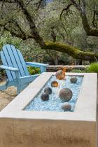Blue Adirondack chair by brazier on Mediterranean terrace