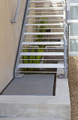 Pond under metal staircase