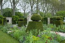 Clipped yew topiary, view towards limestone wall sculpture, Agrostemma githago, Allium atropurpureum, Orlaya grandiflora, Aquilegia vulgaris 'Ruby Port', Nigella damascena 'Albion Black Pod'