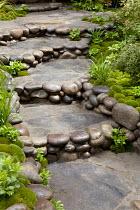Pebble-edged steps in Japanese moss garden