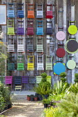 Colourful folding chairs and tables displayed on wall at plant nursery