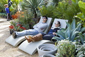 People relaxing on contemporary recliners