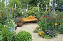 Gravel garden, natural timber bench, crocosmia, Purple sage