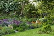 Kitchen garden, raised beds, willow wigwams, Geum 'Totally Tangerine', erysimum